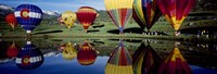 Reflection of hot air balloons in a lake, Snowmass Village, Pitkin County, Colorado, USA Fine Art Print