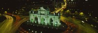 """High angle view of a monument lit up at night, Puerta De Alcala, Plaza De La Independencia, Madrid, Spain by Panoramic Images - 36"""" x 12"""""""