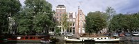 """Netherlands, Amsterdam, Boats in canal by Panoramic Images - 36"""" x 12"""""""