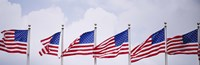 """Low angle view of American flags fluttering in wind by Panoramic Images - 36"""" x 12"""""""
