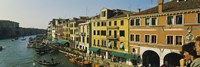 Tourists looking at gondolas in a canal, Venice, Italy Fine Art Print