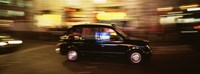 """England, London, Black cab in the night by Panoramic Images - 36"""" x 12"""""""