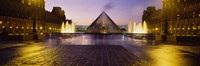 """Museum lit up at night with ghosted image of three men, Louvre Museum, Paris, France by Panoramic Images - 36"""" x 12"""""""