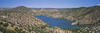 """High angle view of a lake surrounded by hills, Santa Cruz Lake, New Mexico, USA by Panoramic Images - 36"""" x 12"""", FulcrumGallery.com brand"""