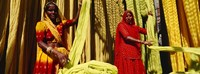 Portrait of two mature women working in a textile industry, Rajasthan, India Fine Art Print