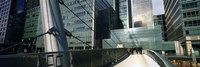 Bridge in front of buildings, Canary Wharf, London, England by Panoramic Images - various sizes