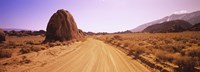 Dirt road passing through an arid landscape, Californian Sierra Nevada, California, USA Fine Art Print
