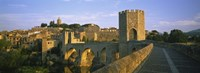 "Footbridge across a river in front of a city, Besalu, Catalonia, Spain by Panoramic Images - 36"" x 12"""