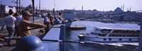 """Side profile of fishermen fishing in a river, Galata Bridge, Istanbul, Turkey by Panoramic Images - 36"""" x 12"""""""