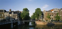 """Bridge across a canal, Amsterdam, Netherlands by Panoramic Images - 36"""" x 12"""""""