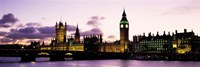 Buildings lit up at dusk, Big Ben, Houses of Parliament, Thames River, City Of Westminster, London, England Framed Print