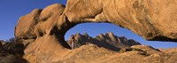 """Mountains viewed through a natural arch with a mother holding her baby, Spitzkoppe, Namib Desert, Namibia by Panoramic Images - 36"""" x 12"""" - $34.99"""