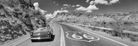 Vintage car moving on Route 66 in black and white, Arizona Framed Print