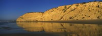 "Reflection of cliff on water, Lagos, Algarve, Portugal by Panoramic Images - 36"" x 12"""