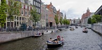 Tourboats in a canal, Amsterdam, Netherlands Fine Art Print