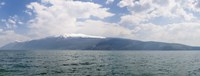 """Lake with mountain range in the background, Monte Baldo, Lake Garda, Lombardy, Italy by Panoramic Images - 36"""" x 12"""", FulcrumGallery.com brand"""