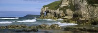 "Rock formations on the beach, Whiterocks Beach, Portrush, County Antrim, Northern Ireland by Panoramic Images - 36"" x 12"""