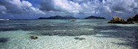 """Snorkeler in the clean waters on Anse Source d'Argent beach, La Digue Island, Seychelles by Panoramic Images - 36"""" x 12"""""""