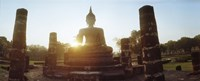 Statue of Buddha at sunset, Sukhothai Historical Park, Sukhothai, Thailand Fine Art Print