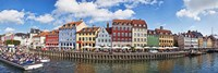 Tourists in a tourboat with buildings along a canal, Nyhavn, Copenhagen, Denmark Fine Art Print