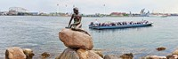 Little Mermaid Statue with tourboat in a canal, Copenhagen, Denmark by Panoramic Images - various sizes - $32.49