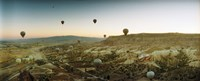 Hot air balloons over a valley, Cappadocia, Central Anatolia Region, Turkey Fine Art Print