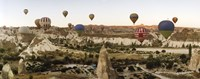 Mulit colored hot air balloons at sunrise over Cappadocia, Central Anatolia Region, Turkey Fine Art Print