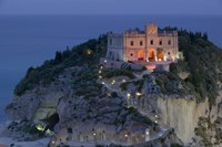 """High angle view of a church lit up at dusk on a cliff, Santa Maria dell Isola, Tropea, Calabria, Italy by Panoramic Images - 16"""" x 11"""""""