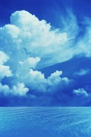 """White clouds in dark blue sky over rippling water by Panoramic Images - 24"""" x 36"""""""