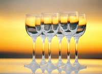 "Row Of Wineglasses Against Golden Yellow shiny Background by Panoramic Images - 36"" x 26"""