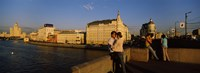 """Side profile of a couple romancing, Moskva River, Moscow, Russia by Panoramic Images - 25"""" x 9"""""""