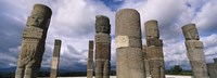 """Low angle view of clouds over statues, Atlantes Statues, Temple of Quetzalcoatl, Tula, Hidalgo State, Mexico by Panoramic Images - 25"""" x 9"""""""