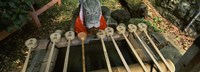 "Water ladles in a shrine, Fushimi Inari-Taisha, Fushimi Ward, Kyoto, Kyoto Prefecture, Kinki Region, Honshu, Japan by Panoramic Images - 25"" x 9"""