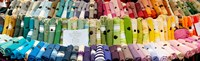 "Tablecloths for sale at a market stall, Lourmarin, Vaucluse, Provence-Alpes-Cote d'Azur, France by Panoramic Images - 30"" x 9"""