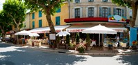 """Restaurants during lunch hour along the Rue Du Marche, Riez, Alpes-de-Haute-Provence, Provence-Alpes-Cote d'Azur, France by Panoramic Images - 19"""" x 9"""""""