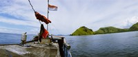 Boat in the sea with islands in the background, Flores Island, Indonesia Fine Art Print