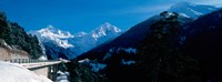 "Bridge through Snowcapped mountain range, Valais Canton, Switzerland by Panoramic Images - 24"" x 9"""