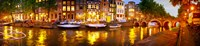 """Buildings along a canal at dusk, Amsterdam, Netherlands by Panoramic Images - 39"""" x 9"""""""
