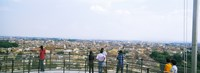 """Tourists looking at city from Leaning Tower Of Pisa, Piazza Dei Miracoli, Pisa, Tuscany, Italy by Panoramic Images - 25"""" x 9"""""""