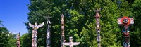 """Totem poles in a a park, Stanley Park, Vancouver, British Columbia, Canada by Panoramic Images - 27"""" x 9"""""""
