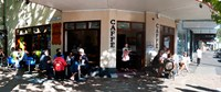 "Cafe on Oxford Street next to Paddington Uniting Church, Sydney, New South Wales, Australia by Panoramic Images - 21"" x 9"""
