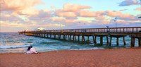 """Couple sitting on the beach at sunset, Fort Lauderdale, Florida, USA by Panoramic Images - 19"""" x 9"""""""