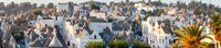 "High angle view of trulli houses in town of Alberobello, Bari Province, Puglia, Italy by Panoramic Images - 41"" x 9"""
