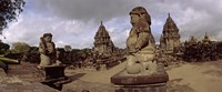 """Statues in 9th century Hindu temple, Indonesia by Panoramic Images - 29"""" x 12"""" - $34.99"""