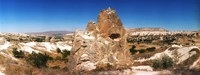 "Single rock in a landscape of rock formations, Cappadocia, Central Anatolia Region, Turkey by Panoramic Images - 32"" x 12"""