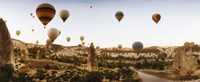 """Hot air balloons over landscape at sunrise, Cappadocia, Central Anatolia Region, Turkey by Panoramic Images - 29"""" x 12"""""""