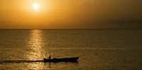 Fishing boat in the sea at sunset, Negril, Westmoreland, Jamaica Fine Art Print