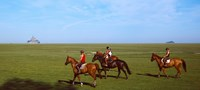 "Horseback riders in a field with Mont Saint-Michel island in background, Manche, Basse-Normandy, France by Panoramic Images - 27"" x 12"""
