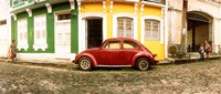 """Small old red car parked in front of colorful building, Pelourinho, Salvador, Bahia, Brazil by Panoramic Images - 28"""" x 12"""""""