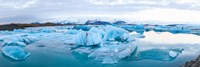 Icebergs floating in glacial lake, Jokulsarlon, South Iceland, Iceland Fine Art Print
